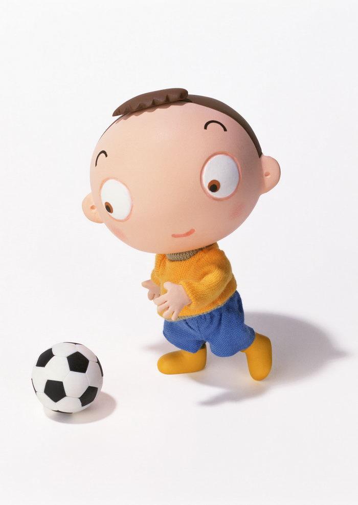 卡通小男孩踢足球,手绘艺术