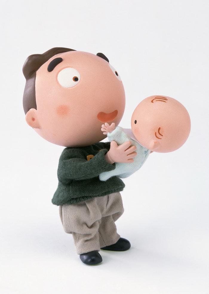 卡通男性抱婴儿图片